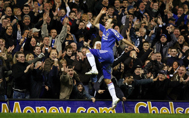 Chelsea's Robben celebrates after scoring against Wigan Athletic during their English Premier League soccer match in London
