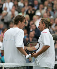 Argentina's Nalbandian shakes hands with Britain's Murray at the Wimbledon tennis championships.