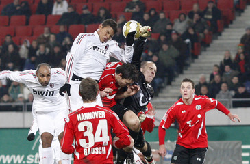 Hannover 96's goalkeeper Enke saves a ball before AC Milan's Thiago Silva during their friendly soccer match in Hanover