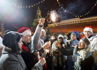 People celebrate New Year's Day on an ice rink in the Red Square in Moscow