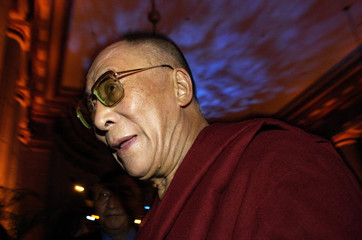 The Dalai Lama departs an International Campaign for Tibet gala in honor of his receiving the Congressional Gold Medal, in Washington
