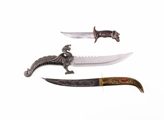 A collection of ancient oriental knives, vintage curved knives