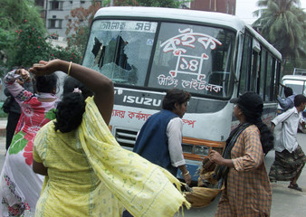 WOMEN ACTIVISTS ATTACK A VEHICLE DURING STRIKE IN DHAKA.