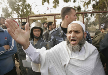 A Palestinian pilgrim takes part in a protest calling on Egypt to help them leave for Saudi Arabia for the Hajj, in front of the Rafah crossing