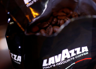 Coffee beans are seen inside a bag of Lavazza coffee in Manchester