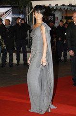 Barbadian singer Rihanna poses as she arrives at the Cannes Festival Palace to attend the NRJ Music Awards