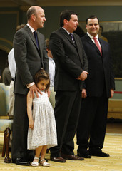 Canada's new International Trade Minister Fortier stands with his daughter during ceremony at Rideau Hall in Ottawa