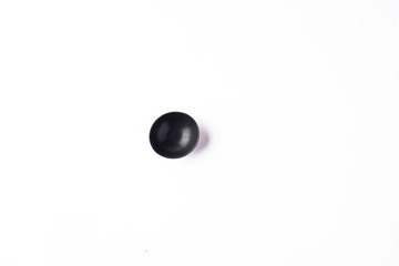 Top view of a Mini black bowl for serving sauces, spices, and condiments
