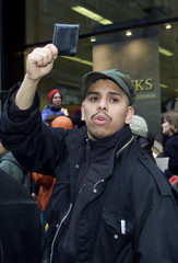 PROTESTER HOLDS WALLET IN NEW YORK DEMONSTRATION.