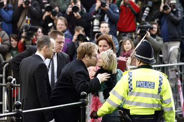 Elton John and David Furnish greet the crowd at the Guildhall in Windsor after their civil ceremony