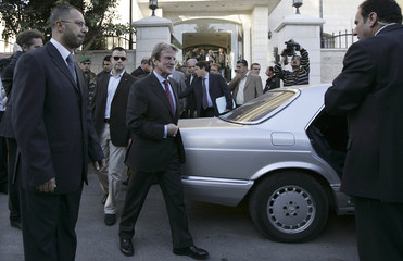 France's Foreign Minister Kouchner walks to his vehicle after meeting in Ramallah