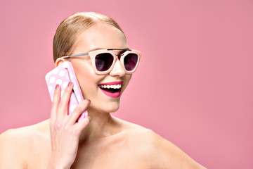 Happy young woman using cellphone