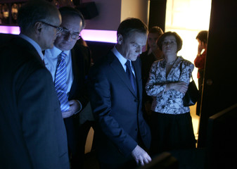 Donald Tusk, leader of the centre-right opposition party Platforma Obywatelska (Civic Platform), checks the latest election results on a screen in Warsaw