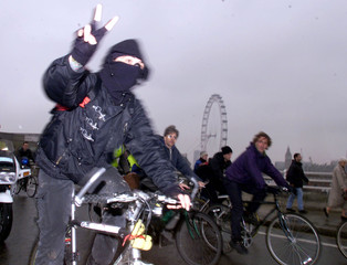 ANTI-CAPITALIST PROTESTORS TAKE TO THE STREETS ON BIKES IN LONDON.