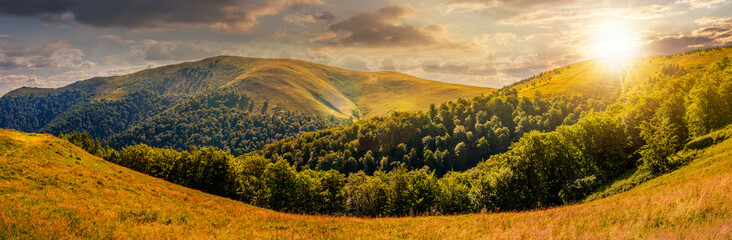 hillside panorama in mountains at sunset