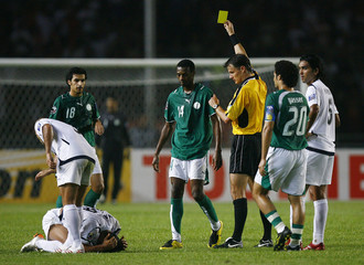 Saudi Arabia's Khariri is shown yellow card during their final match against Iraq at the 2007 AFC Asian Cup soccer tournament in Jakarta