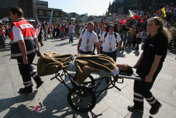 Paramedics carry an unidentified woman after she collapsed near Cologne Cathedral.