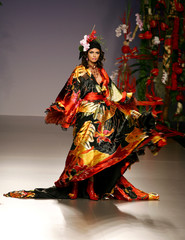 Model displays an outfit created by designer Francis Montesinos during the Autumn/Winter 2006-07 Pasarela Cibeles fashion show in Madrid