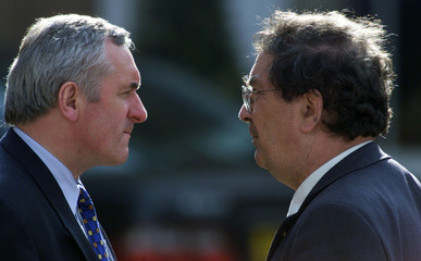 JOHN HUME TALKS WITH BERTIE AHERN AT HILLSBOROUGH.