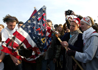 Anti-war protesters burn an American flag as they demonstrate against war in Iraq in Paris , March 2..