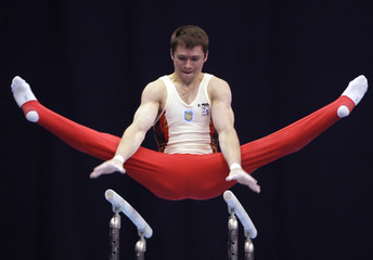 Ukraine's Zozulya competes on the parallel bars during apparatus finals at the World cup in Artistic Gymnastics in Moscow
