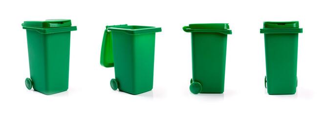 green wheelie waste bin isolated on white background