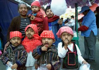 GUATEMALAN GRANDMOTHER JUANA DE LOPEZ POSES FOR A FAMILY PHOTO.
