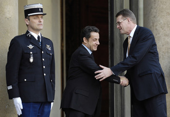 France's President Nicolas Sarkozy greets Finland's Prime Minister Matti Vanhanen after a meeting at the Elysee Palace in Paris