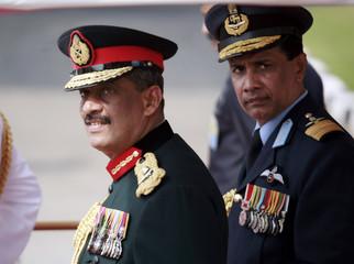 Sri Lankan Army commander Lieutenant General Sarath Fonseka and Air Force commander R. Goonetileke walk out of Bandaranaike International Airport in Colombo