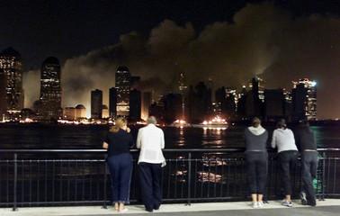 CHANGED NEW YORK SKYLINE AT NIGHT.