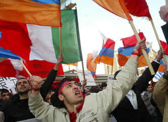Armenian demonstrators shout and wave flags during protest in front of Turkish embassy in Moscow