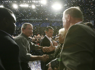 U.S. President Bush greets supporters at a Republican party congressional election rally in Pensacola