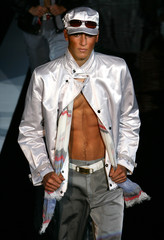 A MODEL PRESENT A CREATION AS PART OF GIORGIO ARMANI'S SPRING/SUMMER 2005 MEN'S COLLECTIONS IN MILAN.