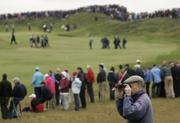 A fan watches play through binoculars on tenth hole at 2008 British Open Golf Championship at Royal Birkdale, northern England
