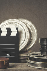 Clapperboard,  a box of film and lens