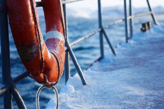 Fishing ship is swimming at sea at winter