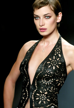 MODEL WEARS A CUTWORK LEATHER VEST AT THE CARMEN MARC VALVO FASHIONSHOW.