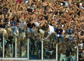 Napoli fans cheer Hamsik's goal during the Italian Serie A soccer league season opener against AS Roma in Rome