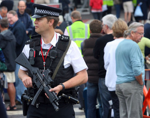 Armed police officer patrols outside Heathrow airport's terminal 4 in London