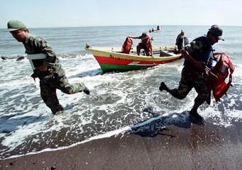 NICARAGUAN NAVY TROOPS LAND AFTER PATROLLING SHORE ALONG HONDURAS BORDER.