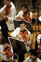 Japanese Crown Prince Naruhito (C) plays the viola at Gakushuin University hall in Tokyo June 15, 20..