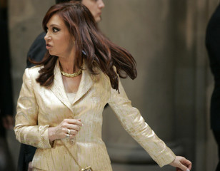 Argentina's first lady Cristina Fernandez leaves a news conference in Mexico City