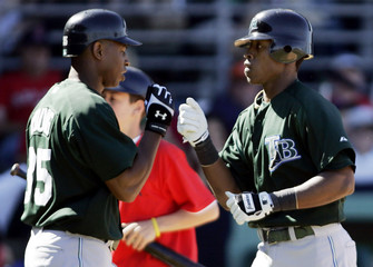 Tampa Bay Devil Rays B.J. Upton and Delmon Young during a spring training game against the Boston Red Sox.