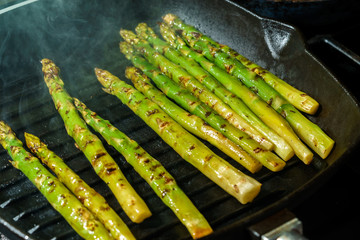 green asparagus fried on grill pan