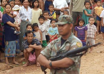 MYANMAR REFUGEES ARE GUARDED AT THEIR CAMP ON THE THAI BORDER.