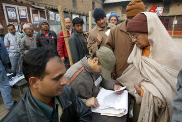 Nepali voters line up to cast ballots during municipal election in Kathmandu