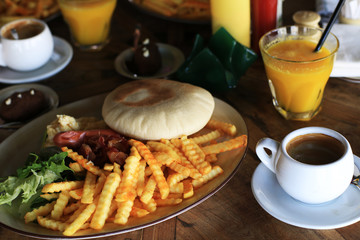 American Breakfast in a cafe with fried potatoes