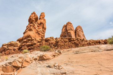 Tall red balancing rocks in Arches National Park in canyons