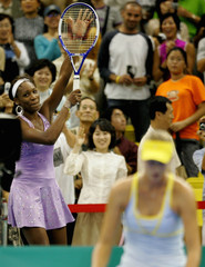 Williams of U.S. reacts after defeating Sharapova of Russia at exhibition tennis match in Seoul.
