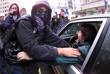 PROTESTER GREETS MOTORIST IN THE STREETS OF WASHINGTON.